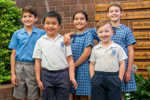 enrolling-now-Revesby-St-Lukes students standing in courtyard